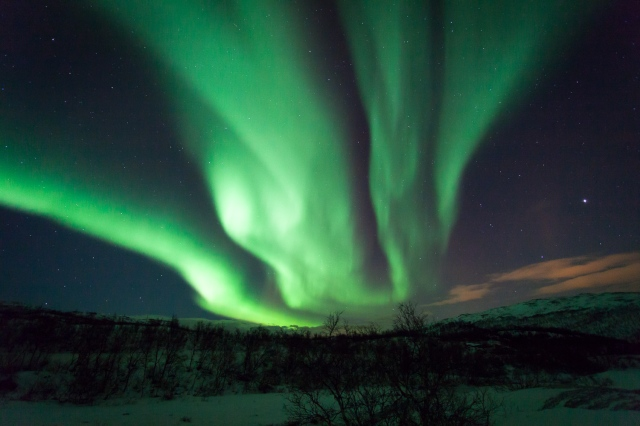 Northern Lights - Aurora Borealis Norway by Svein-Magne Tunli. Via Wiki Commons.